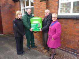 Staffordshire's Alliance handing over a defribrillator